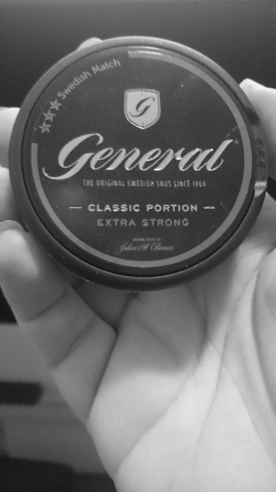 Holding a box of General snus